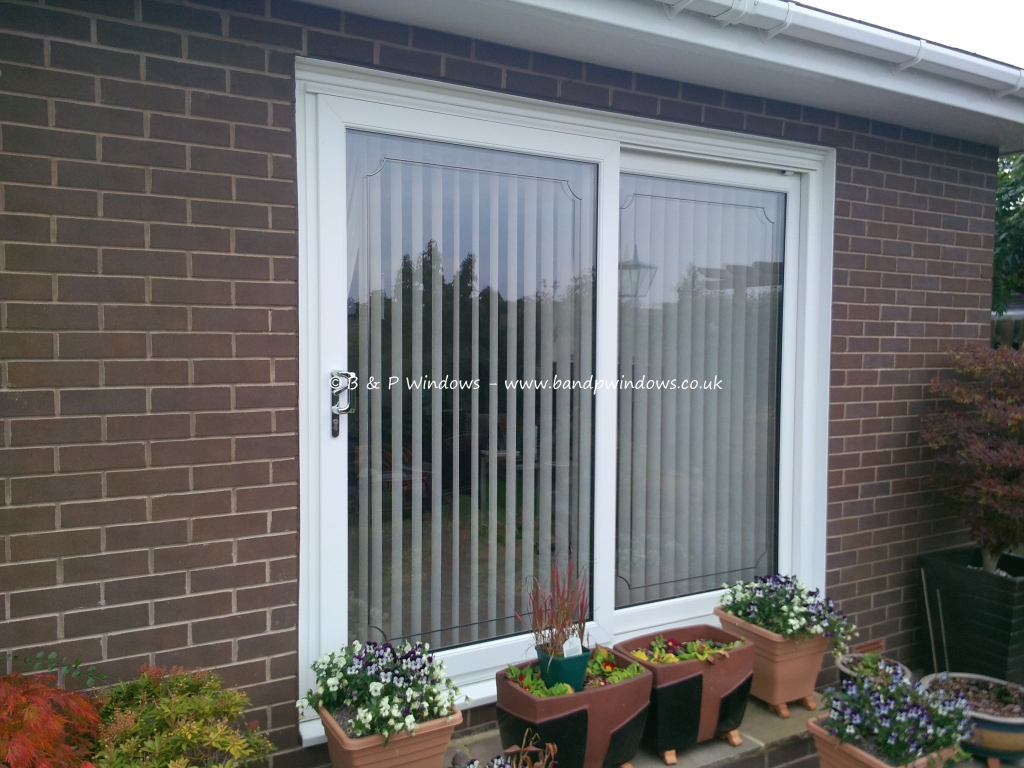 Sliding patio doors b p windows for Non sliding patio doors